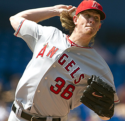 Angels ace Jered Weaver gets roughed up in Toronto, allowing eight runs and eight hits in his shortest outing of the year. (AP)