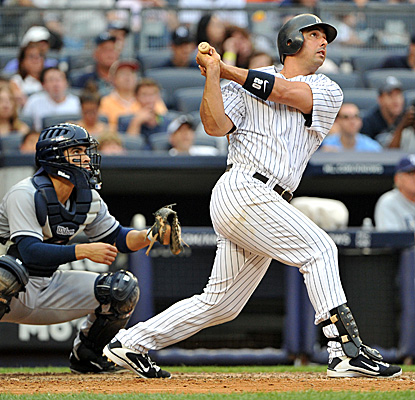 In his return to the Yankees lineup after getting benched, Jorge Posada hits a grand slam and drives in six runs. (Getty Images)