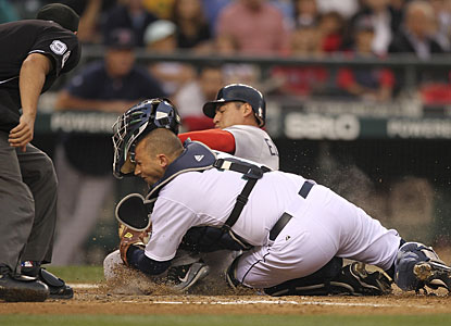 Boston's Jacoby Ellsbury is tagged out at home plate by Josh Bard on a fly ball hit by Dustin Pedroia. (Getty Images)