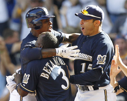 Brewers teammates mob Nyjer Morgan after his 10th inning sacrifice fly completes a series sweep over Pittsburgh. (AP)