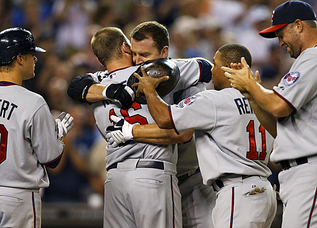 Thome celebrates becoming only the eighth player in MLB history to hit at least 600 home runs. (US Presswire)