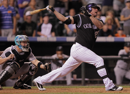 Jason Giambi's three-run homer caps a four-run ninth for the Rockies against the Marlins. (Getty Images)