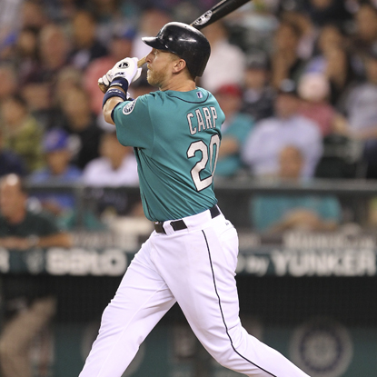 Mike Carp swings through his first of two home runs while helping propel the Mariners to a come-from-behind win.  (Getty Images)