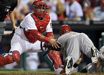 Collin Cowgill dives for the plate to beat Carlos Ruiz's tag and give Arizona the lead in the top of the ninth. (Getty Images)