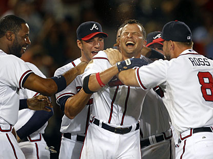 Martin Prado (second from right) celebrates with teammates after driving in the winning run with a single in the 11th. (AP)
