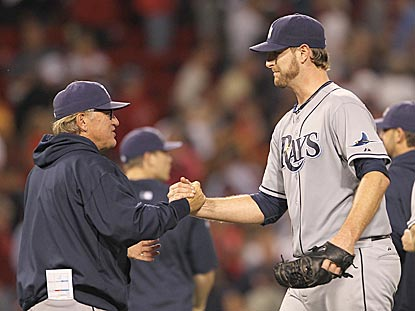 Tampa Bay manager Joe Maddon thanks Jeff Niemann for sparing the Rays bullpen with a complete-game victory.  (Getty Images)