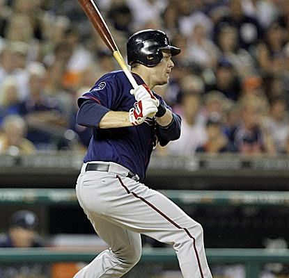 Justin Morneau comes through for the Twins with a bases-loaded single in the ninth inning to secure the victory. (AP)