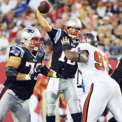 After sitting out New England's preseason opener, Tom Brady throws for 118 yards and two TDs against Tampa Bay. (Getty Images)
