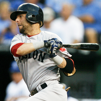 Dustin Pedroia drives in three runs while helping the Red Sox squeak past the Royals.  (Getty Images)