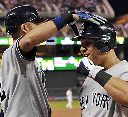 Derek Jeter (left) congratulates Russell Martin on a solid night at the plate, he went 3 for 4 with two homers and three RBI. (Getty Images)