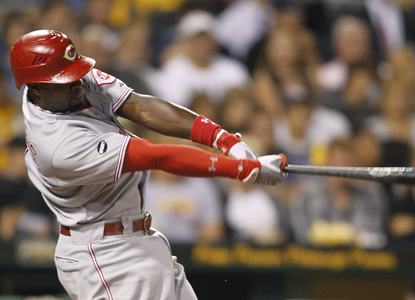 Brandon Phillips goes 3 for 5 with a home run and four RBI against the Pirates.  (Getty Images)