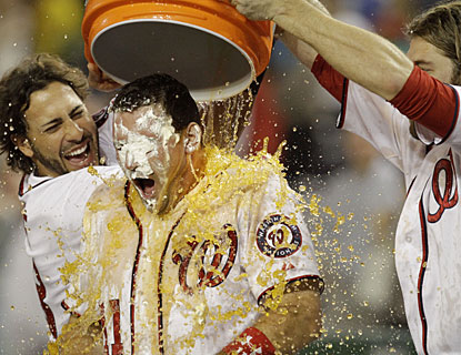 Michael Morse and Jayson Werth pour Gatorade over Ryan Zimmerman, who bashes a grand slam. (AP)