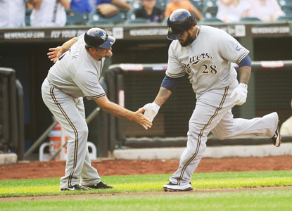 Prince Fielder (right) chalks up two hits, one home run and four RBI against the Mets. (Getty Images)