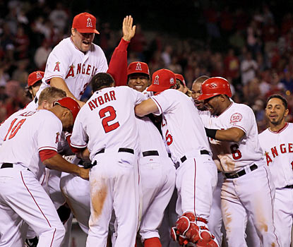Hidden amongst ecstatic Angels, Bobby Abreu receives a proper greeting after hitting in the winning run in the 12th. (Getty Images)