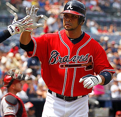 Braves SS Alex Gonzalez crosses home plate after hitting the game-winning home run in the third inning. (Getty Images)
