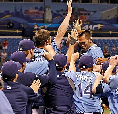 Johnny Damon celebrates with Rays teammates after hitting a walk-off home run to beat the Mariners. (Getty Images)