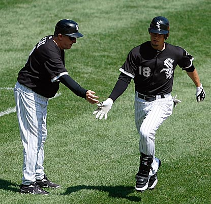 Brent Lillibridge rounds third after hitting a two-run homer as the White Sox rout the Rangers. (Getty Images)