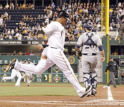 Pittsburgh's Jose Tabata, who goes 5 for 9 in the doubleheader, scores in the first inning in Game 2 on a Neil Walker hit.  (AP)