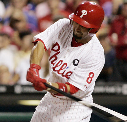 Shane Victorino swings for a two-run triple in the fifth inning as the Phillies beat up on the Mets. (AP)