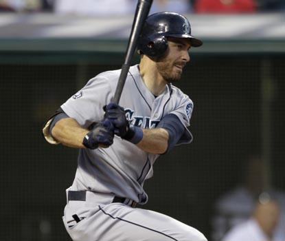 Dustin Ackley delivers a bases-loaded single in the fourth inning, driving in two of his three RBI. (AP)