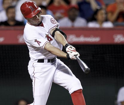 Peter Bourjos plays the hero for the Angels, as his single to left field scores Erick Aybar with the winning run. (AP)