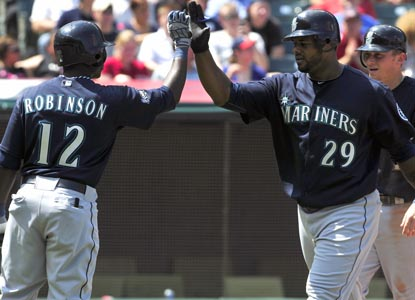 Seattle's Trayvon Robinson congratulates Wily Mo Pena after his two-run fourth-inning homer. (Getty Images)