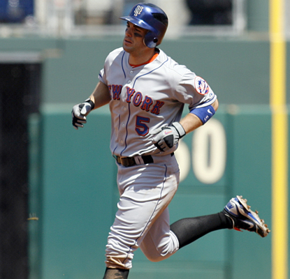 David Wright rounds the bases after hitting a solo home run in the third inning for the Mets. (AP)