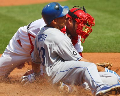 Juan Rivera has three RBI for the Dodgers, and scores as he slides past the tag of Cards catcher Gerald Laird. (Getty Images)