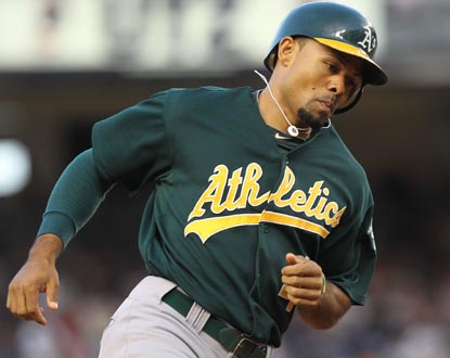 A's outfielder Coco Crisp rounds the bases after the first of his two home runs at Yankee Stadium. (Getty Images)