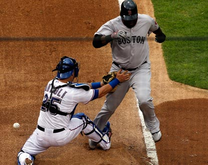 Boston's David Ortiz scores in the first inning when Rangers catcher Mike Napoli drops the ball in a play at home plate. (Getty Images)