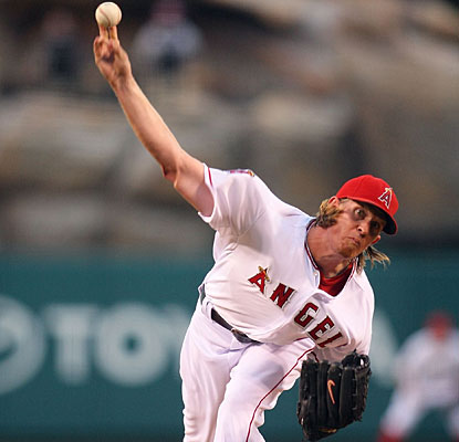 Jered Weaver allows just four hits in seven innings in his first start since signing his huge contract extension. (Getty Images)