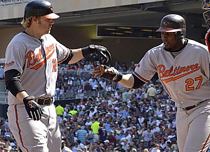 Mark Reynolds (left) drives in three runs, including Vlad Guerrero on his HR in the seventh inning for the O's. (AP)
