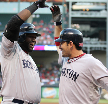 Adrian Gonzalez (right) celebrates his solo home run in the first inning with David Ortiz. (US Presswire)