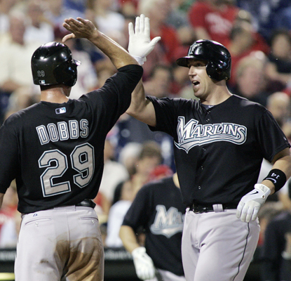 Florida's John Buck (right) is greeted by Gregg Dobbs after hitting a grand slam in the sixth inning against the Phillies. (AP)