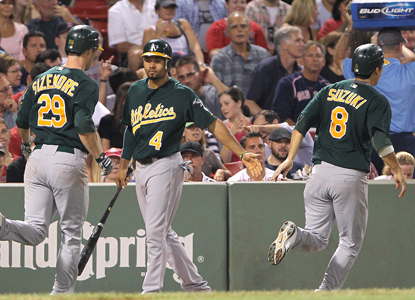 Scott Sizemore (left) celebrates with teammates after smacking a two-run shot in the fourth inning.  (Getty Images)