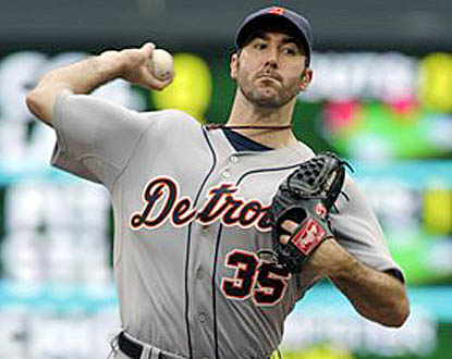 Justin Verlander gives up home runs to Luke Hughes and Jason Repko, but Detroit's ace still picks up his 20th win. (AP)
