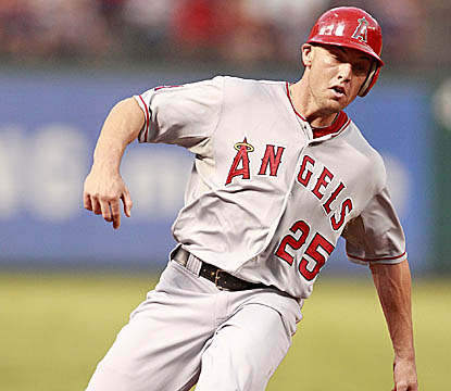 Peter Bourjos circles the bases after hitting one of L.A.'s five solo home runs in its win over Texas. (Getty Images)
