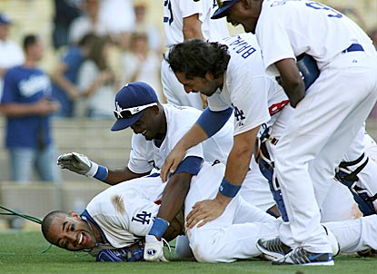 Dodgers hero Matt Kemp (bottom) gladly accepts the modern consequences of hitting a game-ending home run.  (Getty Images)