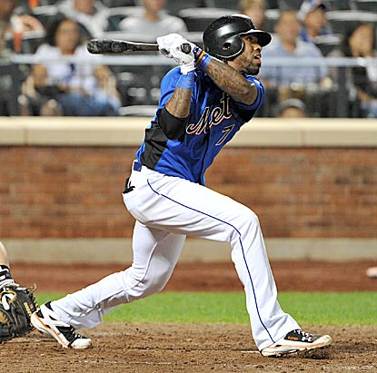 In his return from the DL, Jose Reyes singles in the seventh inning and eventually scores the Mets' fourth run.  (Getty Images)