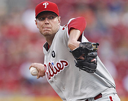Roy Halladay allows just two hits over seven innings, and drives in three runs to lead Philadelphia. (Getty Images)