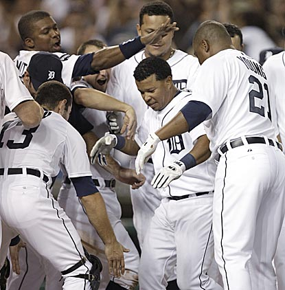 Light-hitting Ramon Santiago (24 HRs in 10 big-league seasons) is the unlikely hero for the first-place Tigers.  (AP)