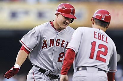 Mike Trout, whom the Angels drafted in the first round in 2009, heads for home after clouting his first home run.  (AP)