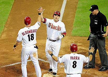 Miguel Montero celebrates with Willie Bloomquist and Gerardo Parra after hitting a three-run blast in the fifth inning.  (US Presswire)
