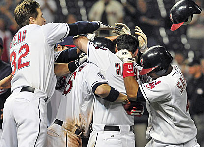 Jack Hannahan of the Indians is mobbed by teammates after his RBI single ends a stalemate between the two bullpens.  (Getty Images)