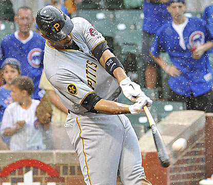 With rain falling at Wrigley, Derrek Lee hits a game-winning grand slam with two outs in the ninth to win it for the Pirates. (Getty Images)