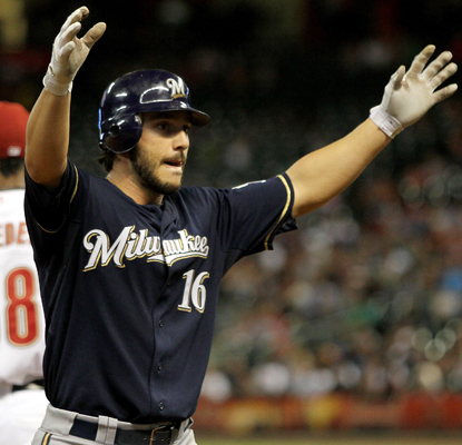 Milwaukee's George Kottaras celebrates his fifth-inning triple as he becomes the first player to hit for the cycle this season. (Getty Images)