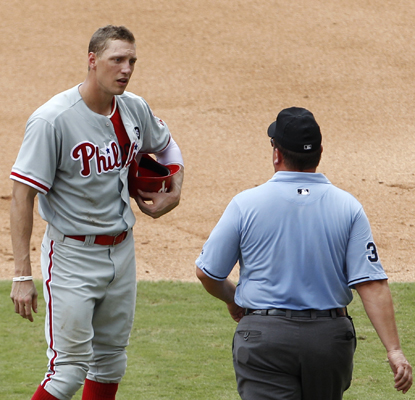 Hunter Pence talks with umpire Sam Holbrook (right) after being ruled out for fan interference in the sixth inning. (AP)