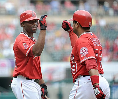 Bobby Abreu celebrates his solo home run with teammate Torii Hunter as the Angels get the win vs. the Twins. (Getty Images)