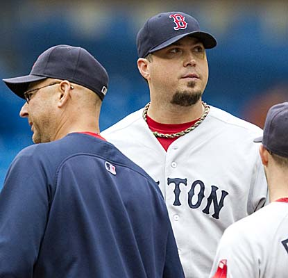 Red Sox manager Terry Francona and Josh Beckett have a word on the mound before Boston's ace leaves with a sprained ankle. (AP)