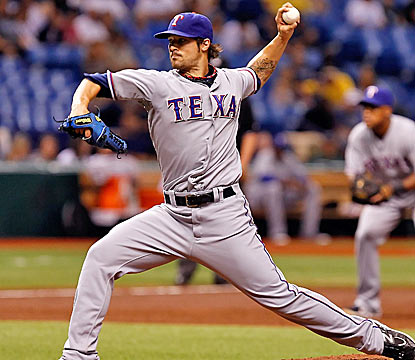 The Rangers' C.J. Wilson wins his 15th game of the season, turning in his third complete game. (Getty Images)